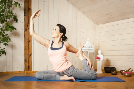 An image of a pretty woman doing yoga at home - Stock Photo - 18351004