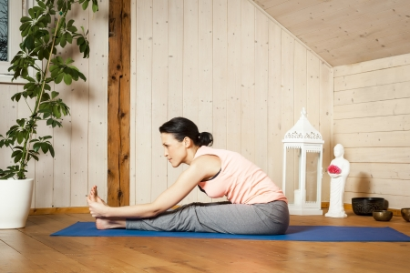 An image of a pretty woman doing yoga at home - Stock Photo - 18351029