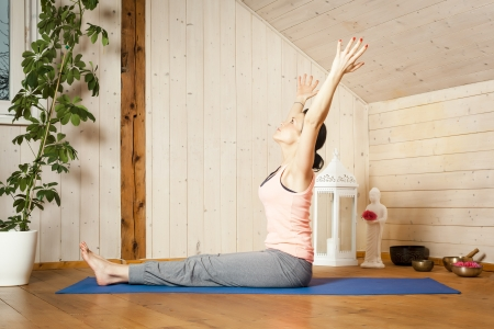 An image of a pretty woman doing yoga at home -  Stock Photo - 18351031