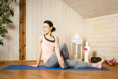 An image of a pretty woman doing yoga at home - Stock Photo - 18351006