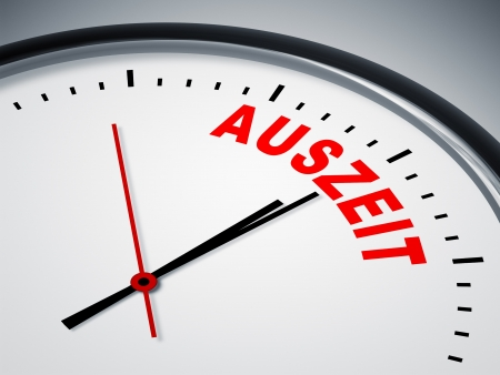 auszeit: An image of a nice clock with Auszeit (time-out) Stock Photo
