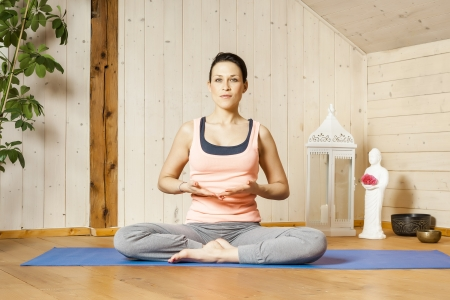 An image of a pretty woman doing yoga at home - Stock Photo - 18599410