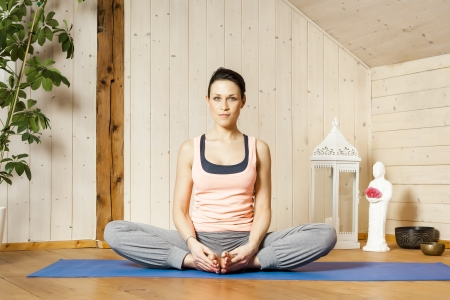 An image of a pretty woman doing yoga at home -  Stock Photo - 18599413