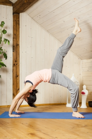 An image of a pretty woman doing yoga at home Stock Photo - 18687648