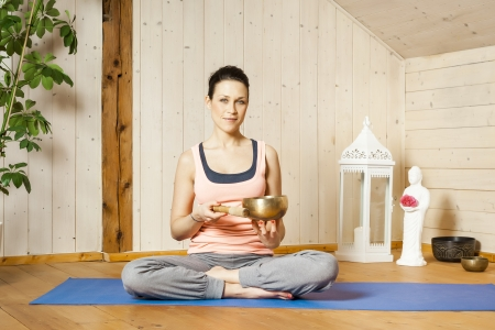 An image of a pretty woman doing yoga at home Stock Photo - 18708447