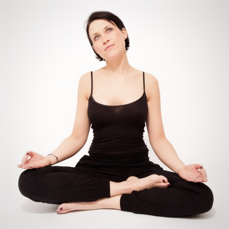 An image of a pretty woman doing yoga at home Stock Photo - 18857090