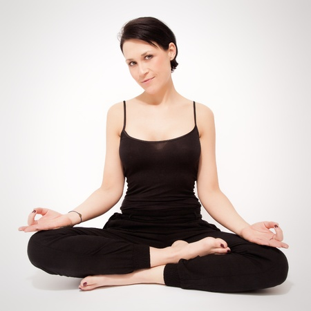 An image of a pretty woman doing yoga at home Stock Photo - 18857089