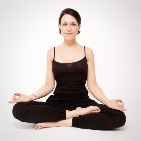 An image of a pretty woman doing yoga at home photo