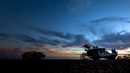 4 wheel: An image of two people having a rest at the sunset Stock Photo