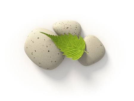 An image of three bright stones and a green leaf Stock Photo - 19469674