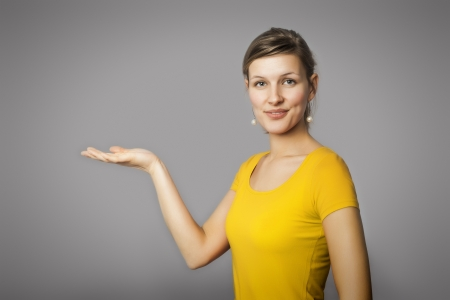 An image of a beautiful presenting woman Stock Photo - 19638485