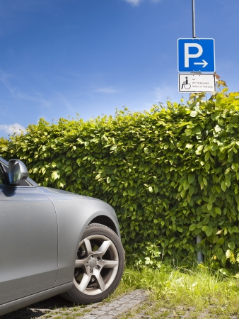 disabled parking sign: An image of a disabled parking area sign in germany Stock Photo