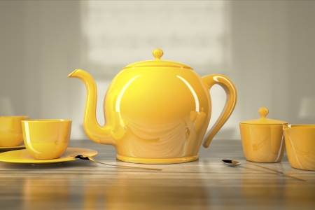 An image of a yellow teapot and teacups photo