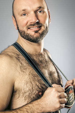 An image of a hairy man in bavarian tradition photo