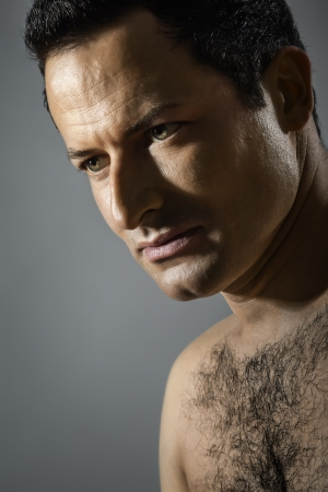hairy chest: An image of a handsome male portrait Stock Photo