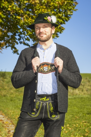 A traditional bavarian man in the autumn nature photo