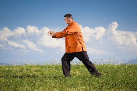 qigong: A man doing Qi-Gong in the green nature Stock Photo