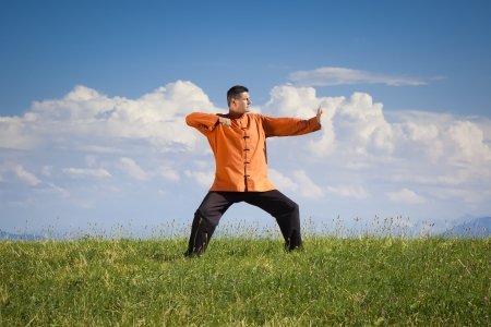 A man doing Qi-Gong in the green nature photo