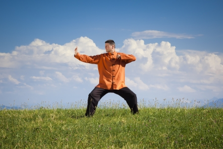 chi kung: A man doing Qi-Gong in the green nature Stock Photo