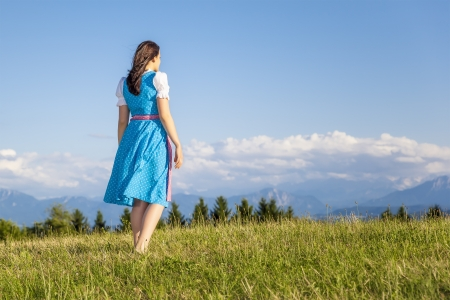tracht: A woman in bavarian traditional dirndl in the nature Stock Photo