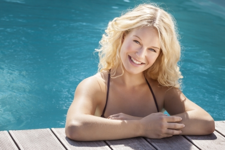 A beautiful blonde woman in the blue pool photo