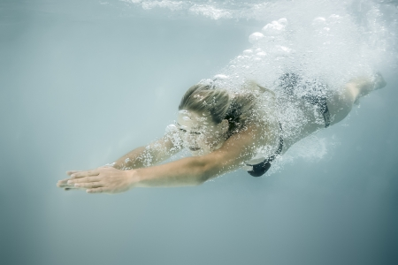 An image of a beautiful diving woman photo