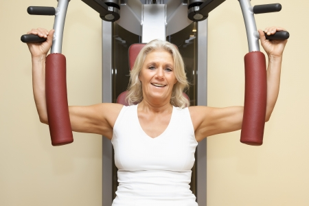 An image of a mature woman doing fitness photo