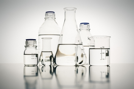 An image of some glass bottles in the laboratory photo