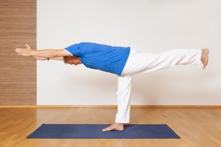 virabhadrasana: An image of a man doing yoga exercises - Virabhadrasana