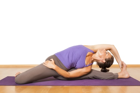 shirshasana: An image of a pretty woman doing yoga