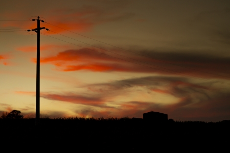An image of a power cable in the evening sunset sky photo
