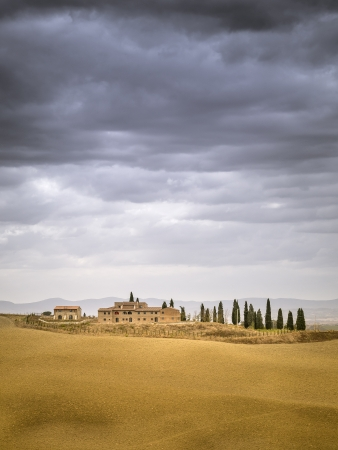 An image of a typical Tuscany landscape with a house photo