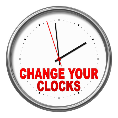 forward: An image of a clock with the text change your clocks Stock Photo