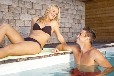 An image of a young couple at the pool photo