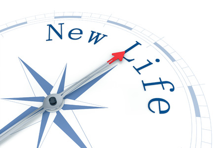new direction: An image of a nice blue compass with the words New Life Stock Photo