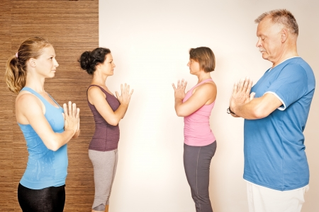 23569361: An image of some people doing yoga exercises