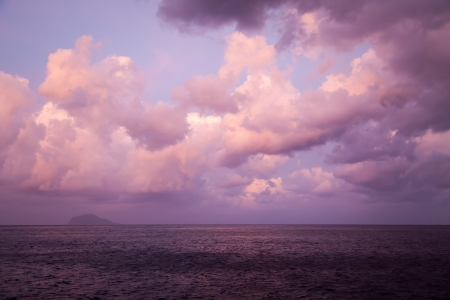 An image of the evening sky over the ocean photo