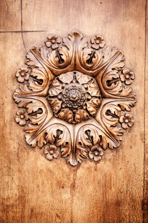 wood carving: A beautiful wooden rose on a door in Tuscany Italy Stock Photo