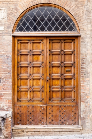 An image of an old door in Siena Italy photo