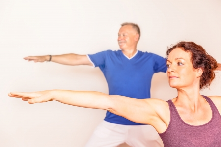 meditation help: An image of a man and a woman doing yoga exercises