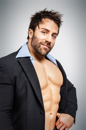 An image of a business man with muscles photo