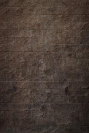 A high quality dark brown stone texture photo