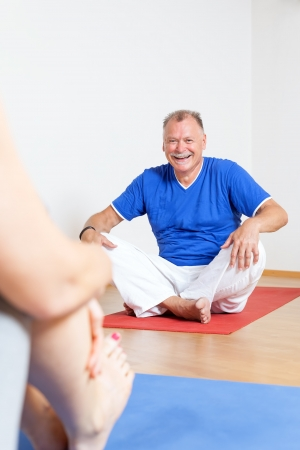 An image of a man doing yoga exercises photo