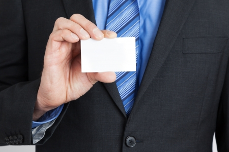 A business man showing his business card  photo