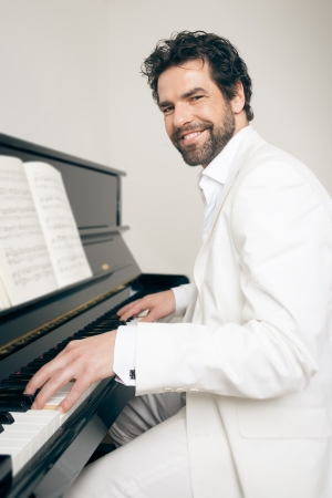 An image of a handsome man playing the piano