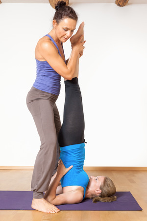 An image of two women doing yoga photo