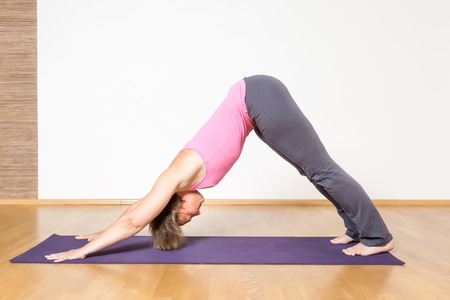 downward: An image of a woman doing yoga Stock Photo