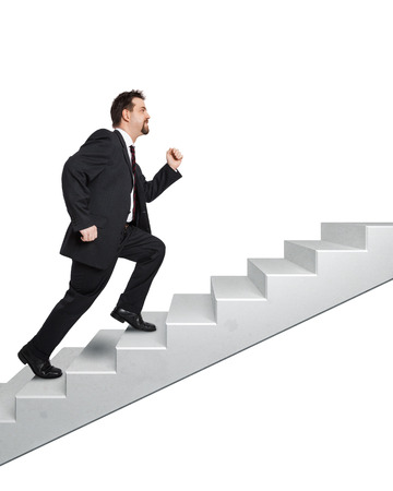 An image of a handsome business man moving upwards photo