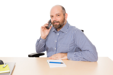 A handsome business man at the phone isolated on white background photo