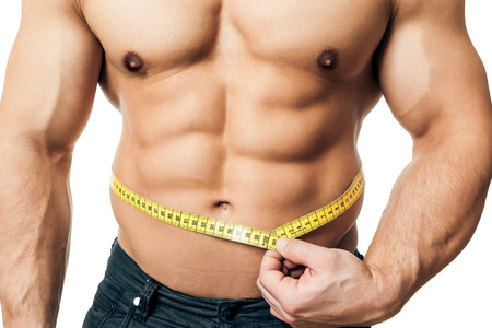 testosterone: An image of a handsome young muscular sports man measure